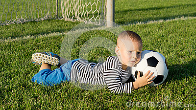 Little boy saves a goal