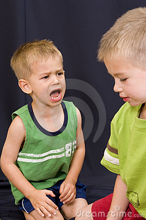 Little boy shouting at his brother