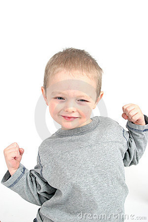 Little boy showing muscles