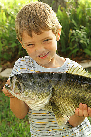 Free Little Boy Showing Off His Fresh Catch Upclose Stock Images - 14252934