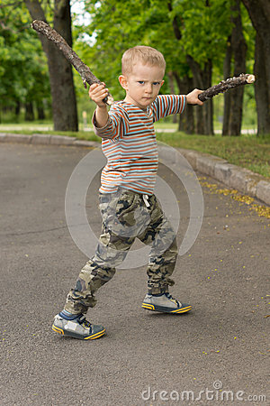 Free Little Boy Showing Off His Stick Fighting Skills Stock Image - 40131881