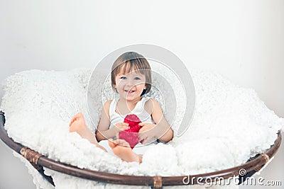 Little boy, sitting in a big chair