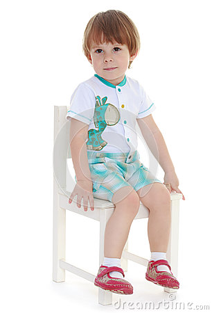 Little Boy Sitting On A Chair Stock Photo Image 41639832