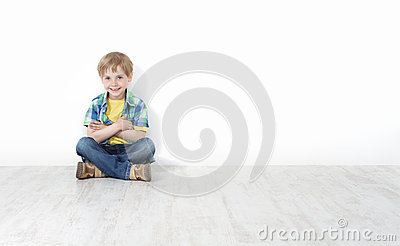 little boy sitting on floor leaning against wall royalty