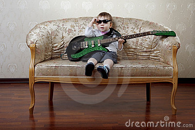 Little boy sitting on the glamorous couch