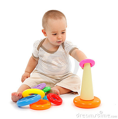 Little boy sitting and playing
