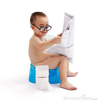 Little boy sitting on potty and reading newspaper