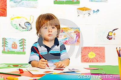 Little boy sketching