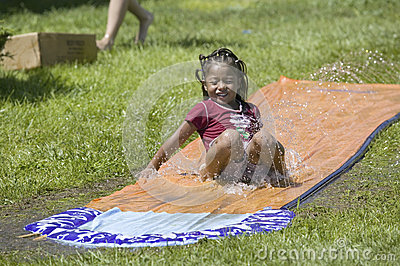 Little boy sliding on a water slide Editorial Image