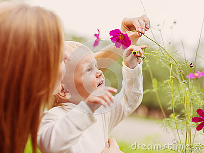 Little Boy Smelling Flower