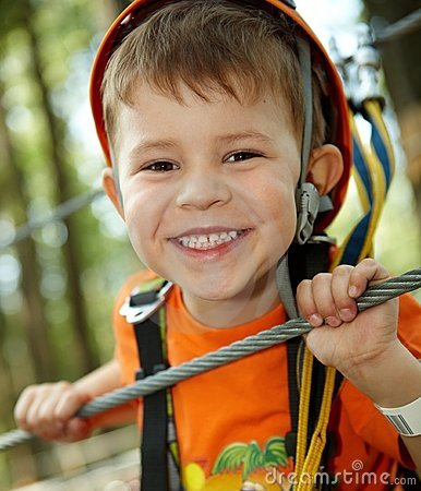 Little boy smiling in adventure park