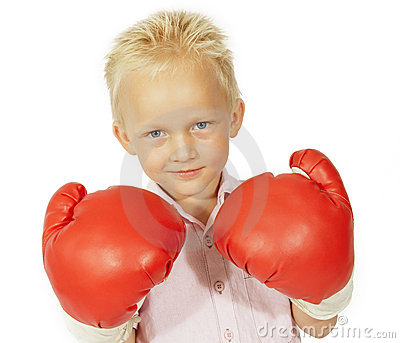 Little boy smiling with big boxing gloves