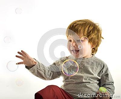 Little boy soap bubbles