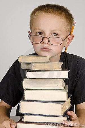 Little boy with a stack of books