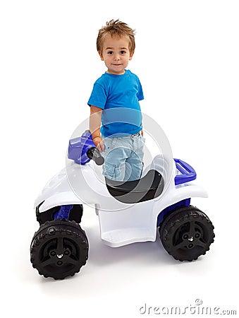 Little boy standing near quad