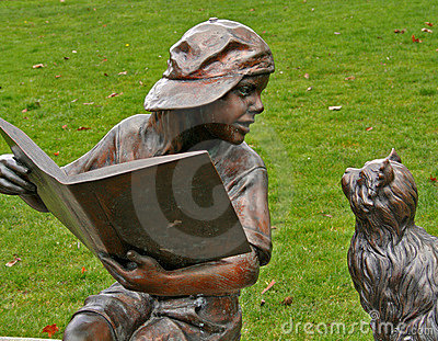 Little Boy Statue Reading to Cat