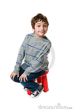 Little boy on a stool