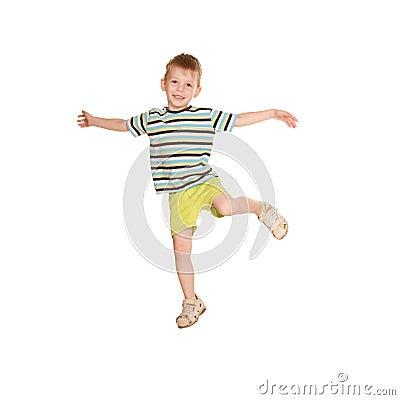 Little boy in striped T-shirt dancing.