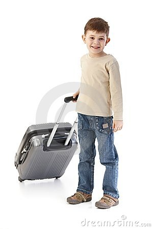 Little boy with suitcase smiling