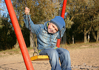 Little boy on swing