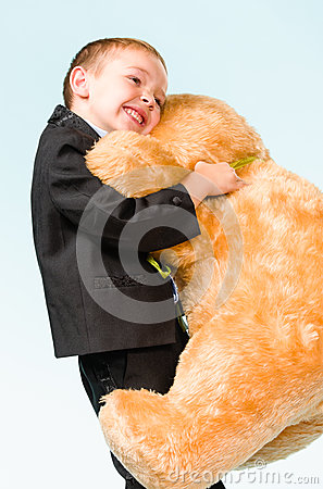 Little boy and teddy bear