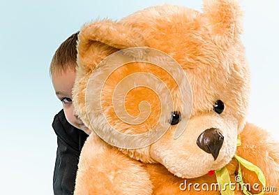 Little boy and teddy bear