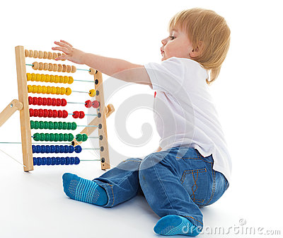 Little boy thinks the accounts Stock Photo