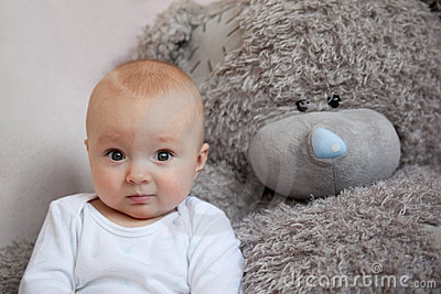 Little boy together favourite teddy