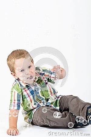 Little boy touching bubbles
