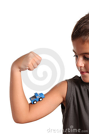 Little boy with  toy car on the muscle
