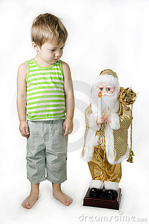 Little Boy and toy Santa Claus