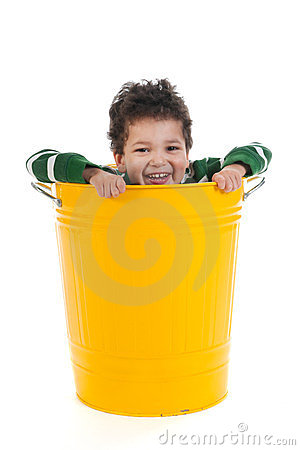 Little boy in trash can