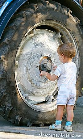 Little boy and truck wheel