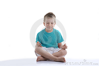 Little boy trying to concentrate for meditation