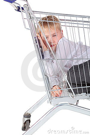 Little boy is trying to sleep in shopping basket