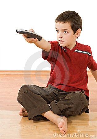 Little boy with a tv remote control