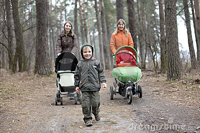 Little boy and two mums with carriages