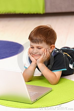Little boy using computer at home