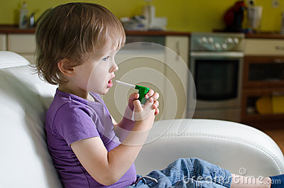 Little boy using inhaler