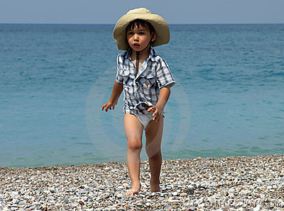 Little boy walking beach