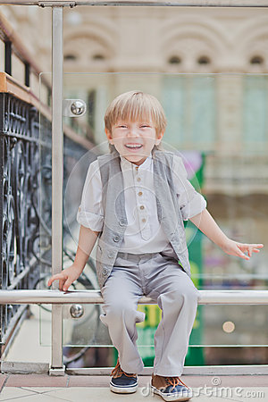 Little boy walking in big supermarket