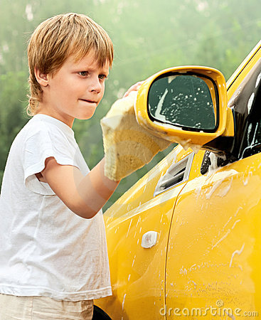 Little boy washing car.