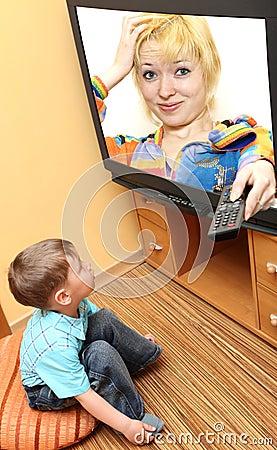 Little boy watching cinema on TV