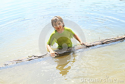 Little boy in water with trunk