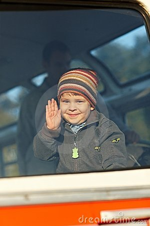 Little boy waving hand