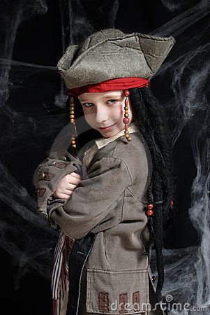 Little boy wearing pirate costume