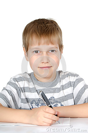 The little boy writes to writing-books a ball pen