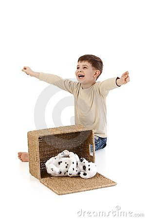 Little boy yelling happily at dog