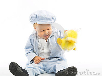 Little boy with yellow toy.