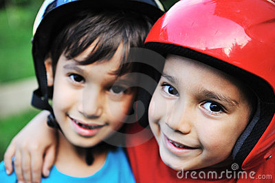 Little boys  with biking safety helmet